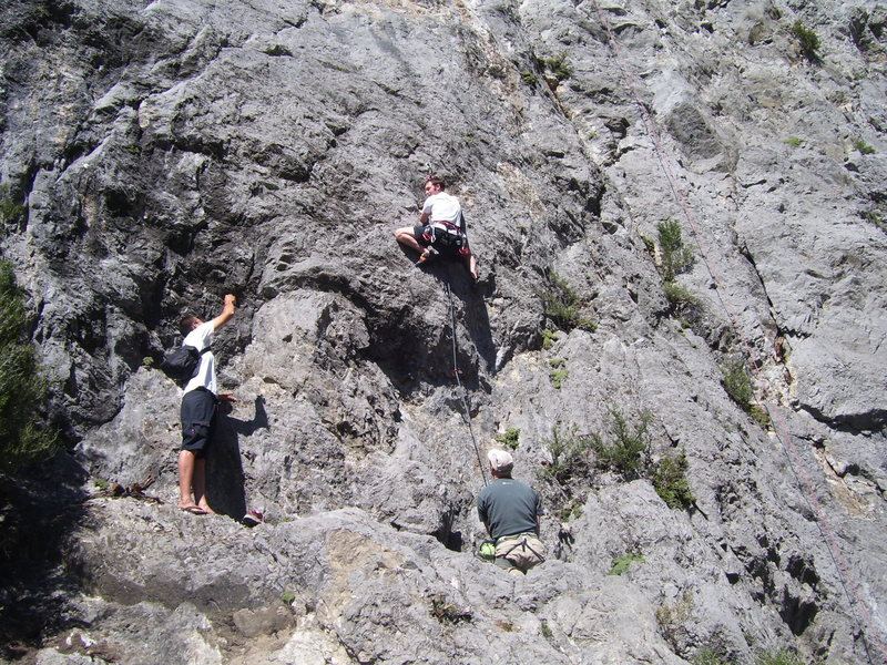 """Aaron Shamy posing for pictures on the start of """"Anti-Gravity."""" You can see me belaying him on the hidden landing."""
