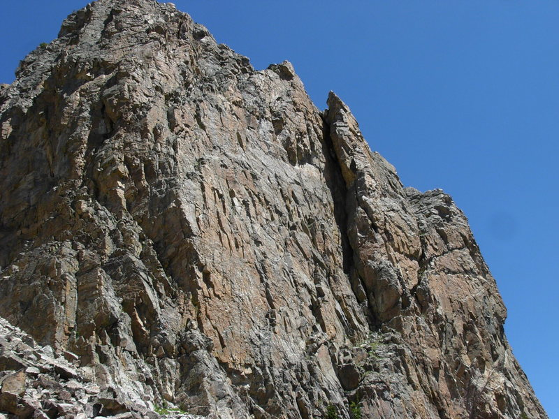 Main portion of Rock Springs Buttress. Exum Arete is the right edge of the huge cleft.