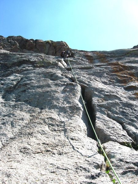 Aaron Martinuzzi on the bulge crux of the route.