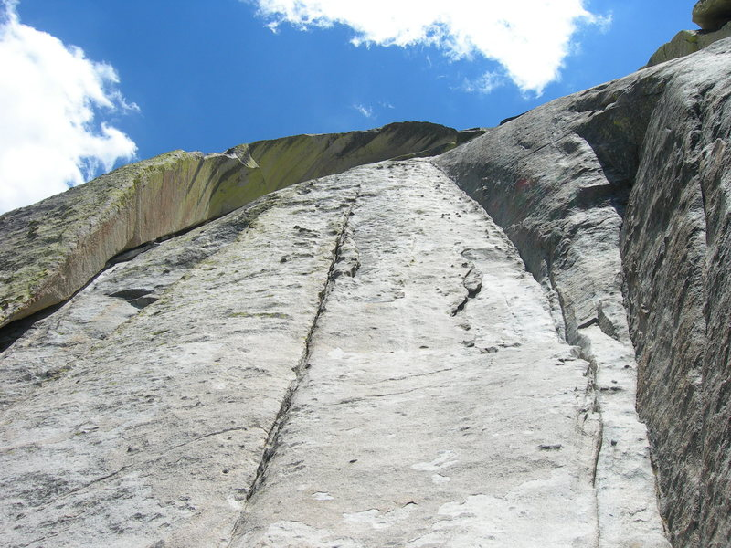 Rock Climbing Photo: First pitch is the curving 5.7 crack on the right.