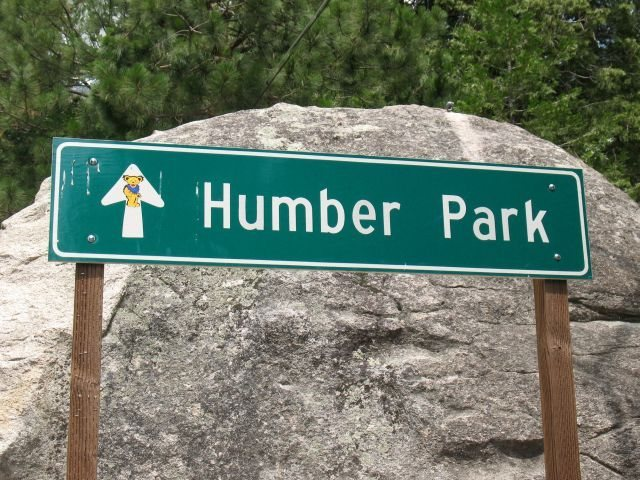 The climber's trail starts almost directly opposite this sign, which is just past Forest Drive.