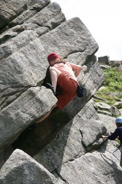 Making the crux moves on Wednesday Climb, 5.10a