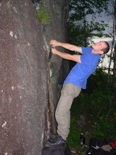 Richard cleaning out the bottom of the crack to the left of the thin Sigourney Weaver Crack.