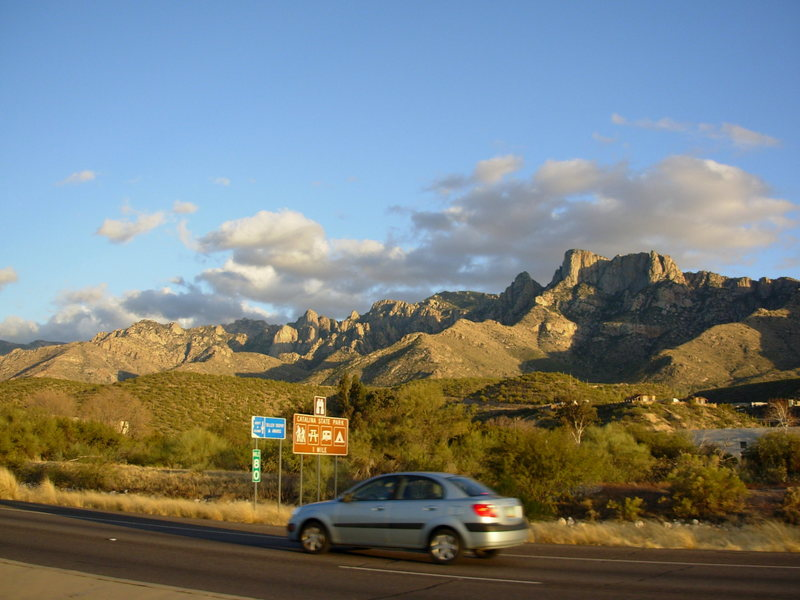 Catalina S.P. from the main road. Leviathon is the large face above the signs. Wilderness Dome is the one above and behind it. Table Mtn is the big'n on the far right.