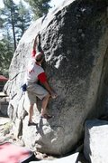 Rock Climbing Photo: Making the long reach at the start of Blind Hog, V...