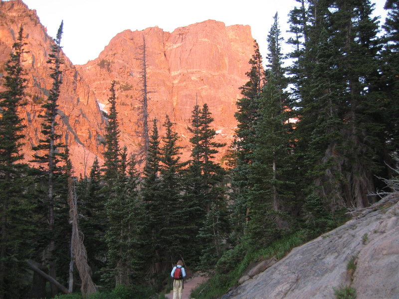 MaryKay and our climb, the first buttress of Hallet Peak, illuminated with the Alpenglow. 071908