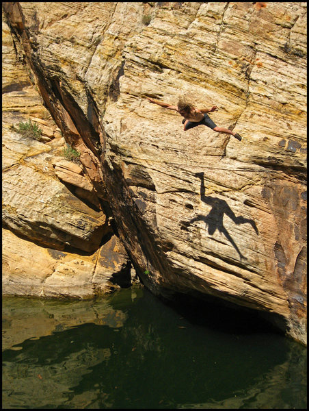 Jumping in after sending a short but sweet DWS problem near the lunch spot.  Check out the shadow!    <br> The overhanging crack up dark rock on the left is great, and the low roof below me is a hard tread-water start.  Photo by Brenda O.