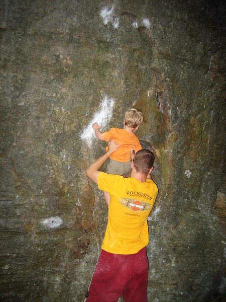 Rock Climbing Photo: He's a little short yet to pull off the first move...