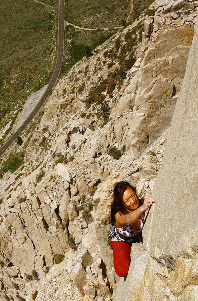 Elizabeth passing around the crux on p-2, 'West Face'