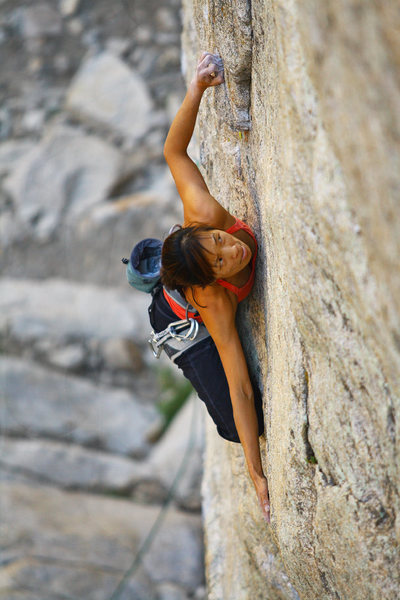 Elizabeth shopping for holds on the ultra classic Window Shopper (5.11c) on the Mustache Wall.