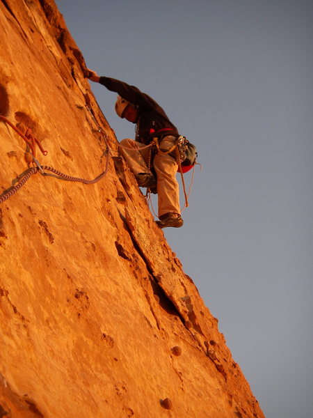 Drilling on lead during the FA of the 5 pitch climb &quot;The Face&quot; <br> Sh'Karat Msaid, Wadi Araba, Jordan