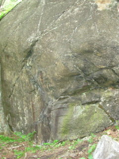The starting holds are just above (and slightly left of) the green strip of lichen.