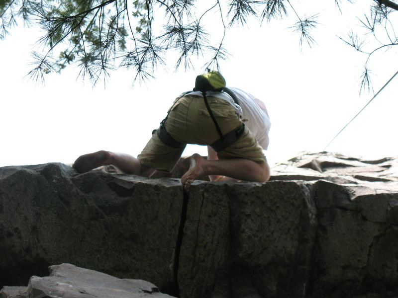 Chris barefoot climbing Roger's Roof. <br> <br> Nice toe jam!<br> <br> photo by: Angie Olson