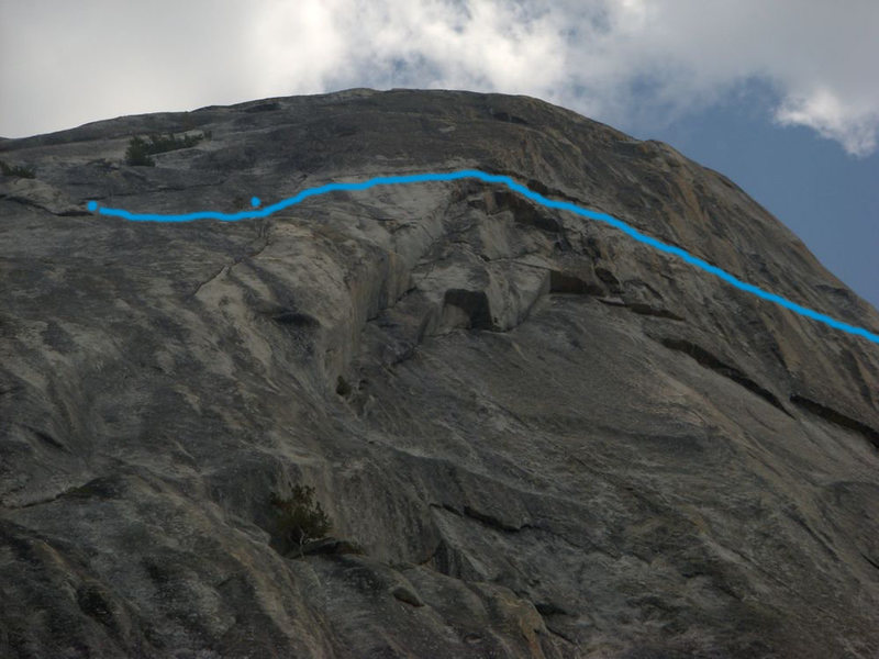 On the Lamb. The blue line runs just below the location of this line. The left dot is the location of the start of the first pitch. The second (right) dot is the approximate location of the first belay. The tree is a good reference point. Hope this is helpful.