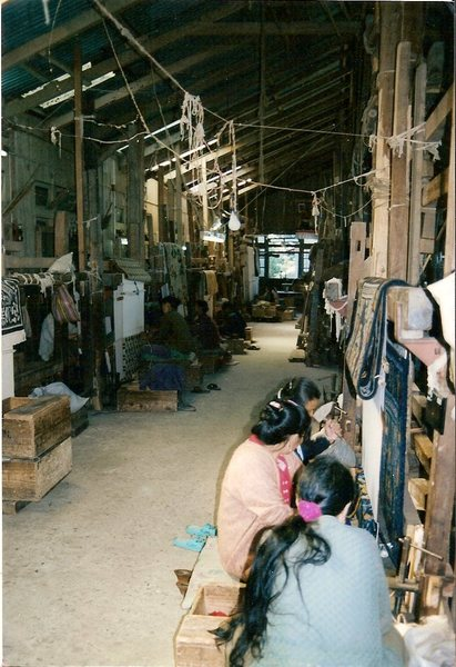 Tibetan refugees at the self-help center weaving rugs. They do export their products to the U.S.