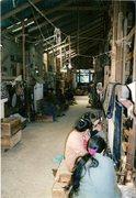 Rock Climbing Photo: Tibetan refugees at the self-help center weaving r...