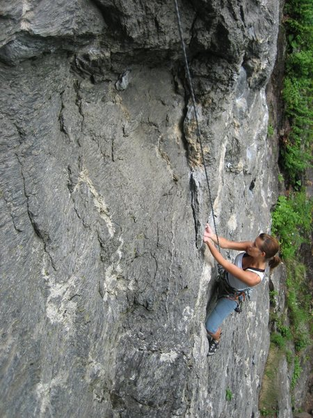 Suzanne Knower approaches the roof crux. Photo by big brother.