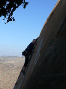 Rock Climbing Photo: Making the high step and reach for the traverse mo...
