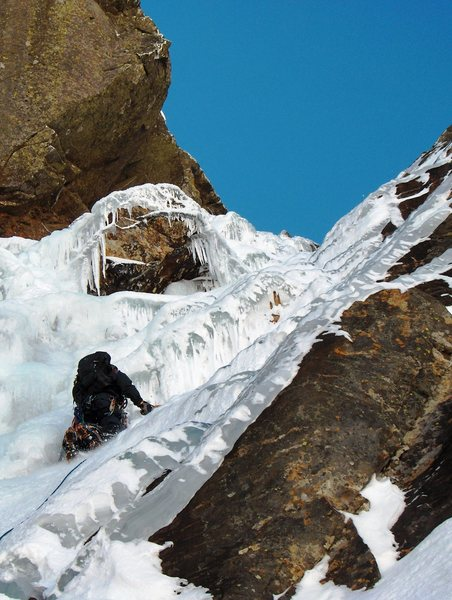 A friend of mine leading the first pitch of Pinnacle Gully (WI3+) on Mount Washington in NH. It was cold (-20) and the ice was brittle so we ended up bailing of an rusty knifeblade and #4 nut.