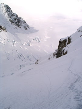 Looking back down towards the crevasse field as the route begins to climb the left side of the basin