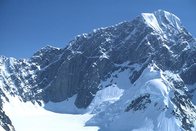 The west face of Mt. Huntington from the Upper Tokasitna.  The Harvard route ascends this wall on the right side of the photo to the sunlit shoulder.  The left (NW) ridge is the first ascent route.