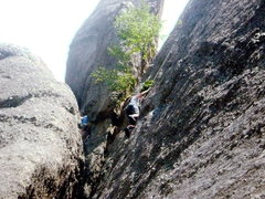 One of my 13 year olds climbing Make Believe in the Marker area of Mount Rushmore.
