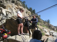Emmy prepping to cross the river before her first climb in boulder canyon