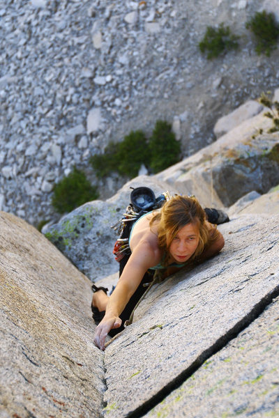 The wife on pitch 1 of the west face (5.10a) of Cardinal Pinnacle.