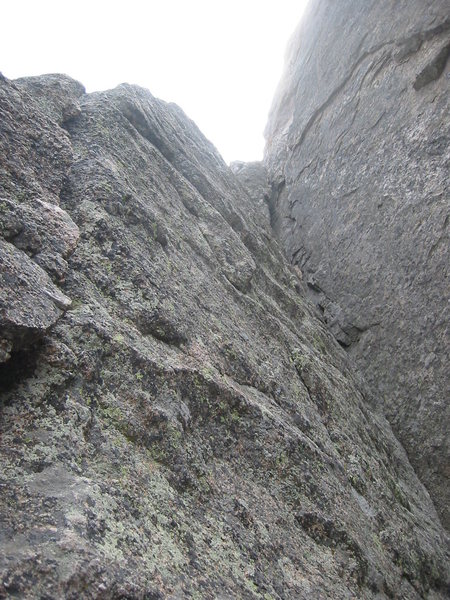 This is the V-notch exit from the belay.  It is easy (although I would call it more than 5.0) and saves the crack finish for Empor.