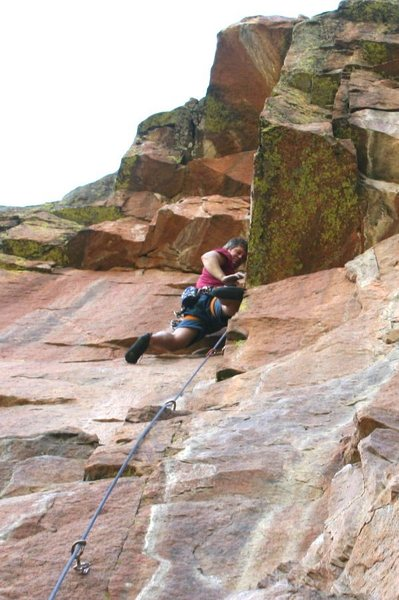 Eric on the clean granite of the Red Wall. The big roof above is skirted right with a delicate undercling.