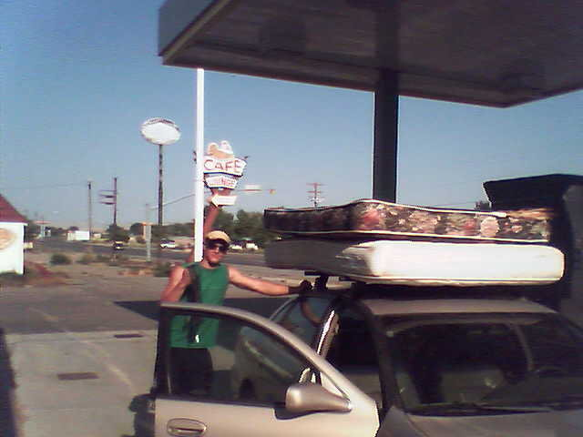we can't afford crash pads so we cam-strapped thrift store mattresses to the top of leland's car