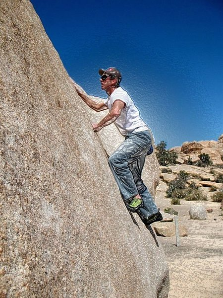 James climbing the Hensel Face (V0) on a really hot day, Joshua Tree NP