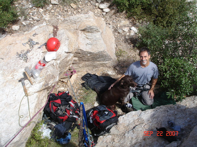 Tony Horness with Kiara the crag dog on top of the Cave next to the top of the Tall wall