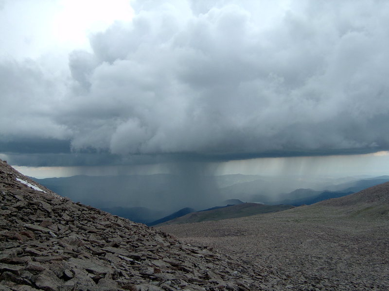 Watching a storm over Estes from the Boulderfield, 2004.