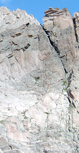 The First belay is right in the corner of the roof where the rock changes from light to dark.