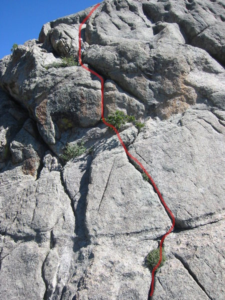 The route for Summer Breeze.  (some pictures show people taking the crack to the right of the pine tree, so maybe I am wrong about taking the left one)  Also, we  belayed where the guy is standing rather than by the pine tree.  This allowed for more rope on the next pitch to the top.