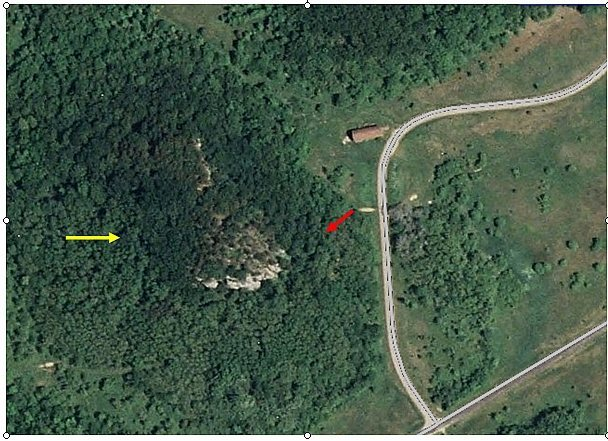Aerial of the horse barn, the Qual Wall is the obvious rock formation in the middle.  Red arrow to the trail and wall.  Yellow arrow marks the approximate location of the Lonely boulders.
