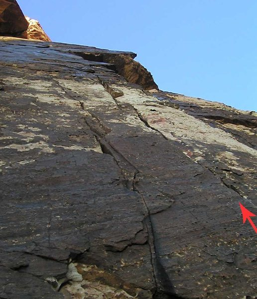 From the Dark Shadows belay ledge, Chasing Shadows moves right to the second crack.