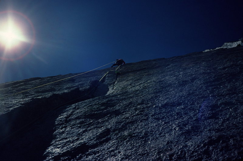 Chip Ruckgaber leading the crux pitch of D7.<br> July 87