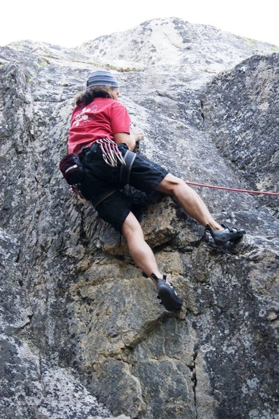 Moving into the crux moves of The Quickening, 5.10b