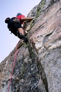Rock Climbing Photo: Moving through the tricky section that gains the s...