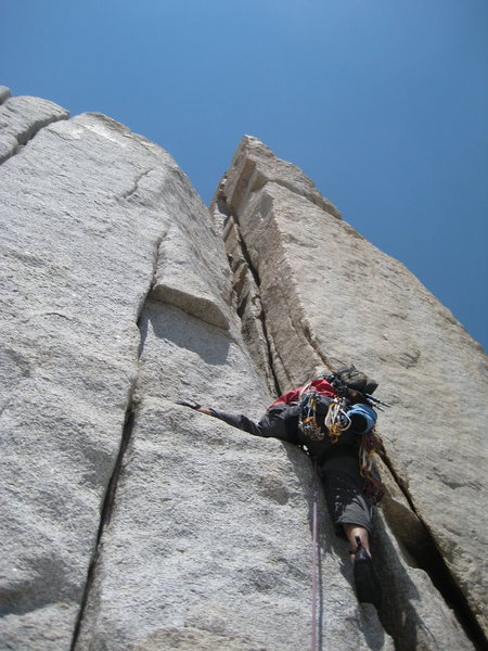 Rock Climbing Photo: Duke leading up the 5.8 chimney.