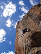 Rock Climbing Photo: Crack climbing at Split Rock. The .12a bolted blac...