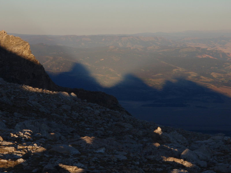 The Shadow of the Grand and the Middle Teton as seen during the sunset from the lower saddle