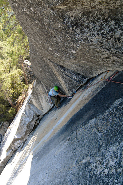 Rob Chaney cleans the Last Dihedral, at Dome Rock.  <br> <br> This portion of the route is protected by a single compression bolt as well as large gear that is placed atop detached flakes or inside a moss-choked crack (very sketchy).  If only it were as clean as it looks.