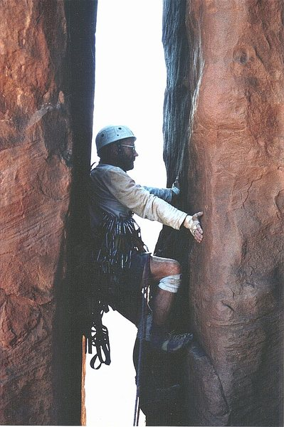 P.Ross approaching the start of the long bolt ladder of the last pitch