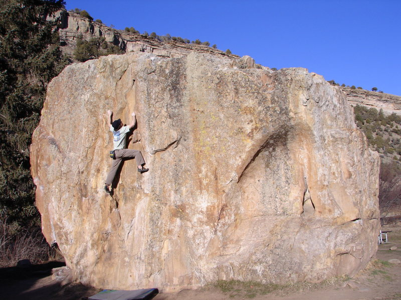 Problem climbs arching rock left of lower slab, and right of me.