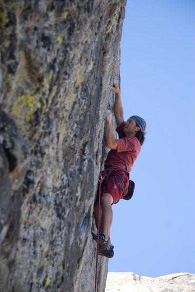 Working hard on the steep finishing wall of Goldilocks, 5.11a