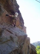 Rock Climbing Photo: Doing the line via toprope--trying to turn the roo...
