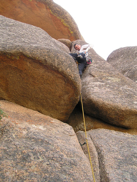 Me nearing the crux on Lower Slot (Left Variation).<br> <br> Photo by Taimi.